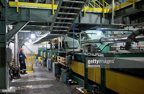 A worker monitors conveyors used to move the biomass from silos into the furnace at the Atikokan Generating Station in Atikokan Ontario Canada on...