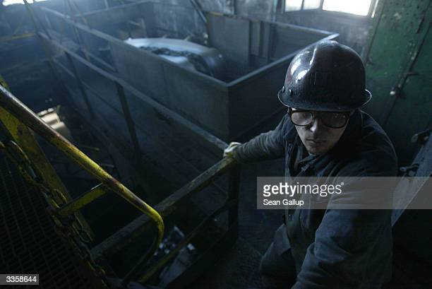 A worker monitors high quality coal emerging from the Wieczorek coal mine April 14 2004 in Katowice Poland Poland will be the largest producer of...