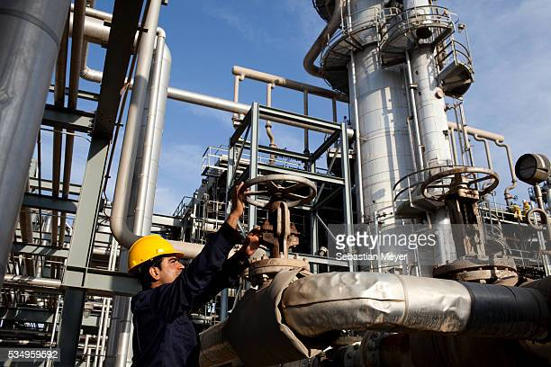 A worker monitors pressure levels at the Kar Refinery in Erbil Iraq An oil boom is underway in the autonomous northern region of Iraqi Kurdistan...