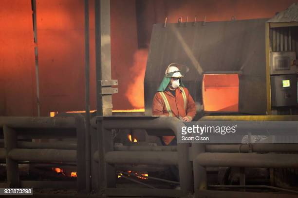 A worker monitors the operation as steel is melted at 3000 degrees Fahrenheit in an electric arc furnace at the NLMK Indiana steel mill on March 15...