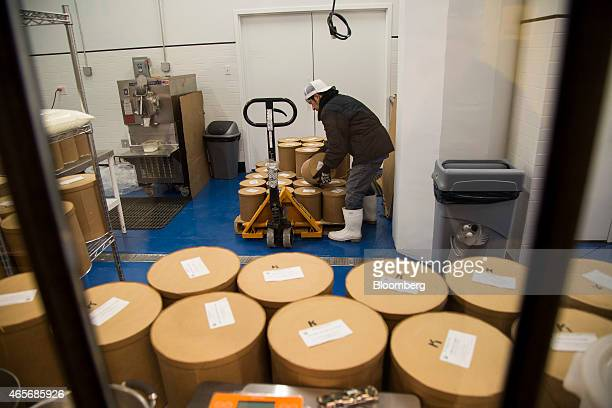 A worker moves a container of ice cream at Blue Marble's ice cream plant inside the Industry City complex in the Sunset Park section of the Brooklyn...