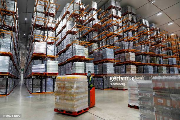Worker moves a pallet of drinks at the Refresco soft-drink bottling factory in Kegworth, U.K., on Tuesday, Oct. 5, 2021. PAI Partners is considering...