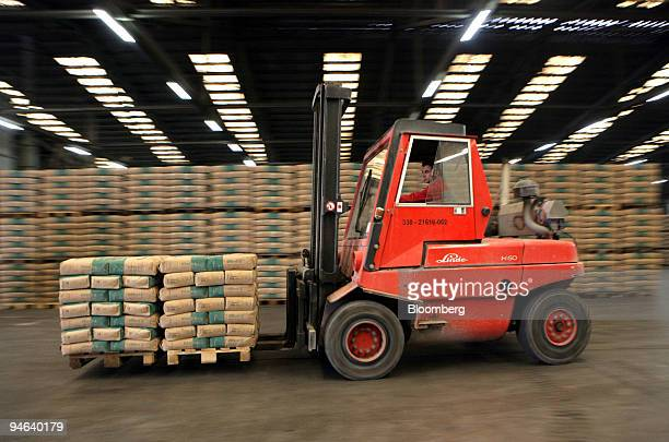 A worker moves cement bags on a fork lift truck at the Holcim cement factory in Dotternhausen Germany Tuesday Aug 21 2007 Holcim Ltd the world's...
