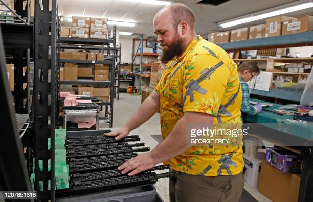 A worker moves finished AR15 rifle barrels for storage at Delta Team Tactical in Orem Utah on March 20 2020 Gun stores in the US are reporting a...