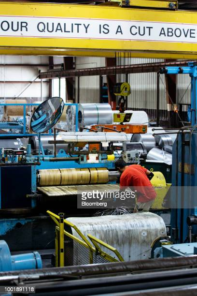 A steel tool chest component is coated in red paint at a Stanley Black Decker Inc Craftsman Tools manufacturing facility in Sedalia Missouri US on...