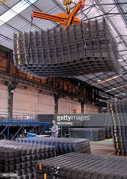 A worker moves rebar for shipment at a Gerdau SA steel plant in Sao Jose dos Campos State of Sao Paulo Brazil on Sept 5 2007 Cia Siderurugica...