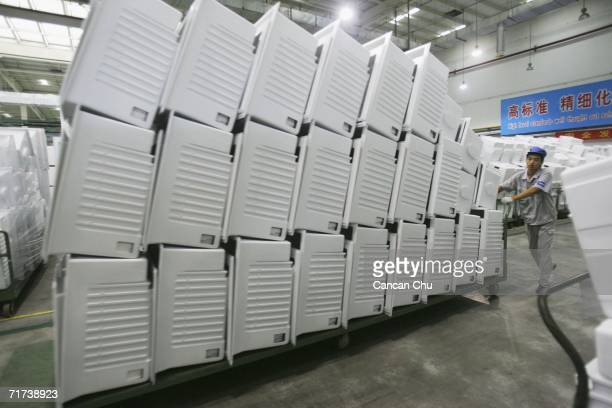 Worker moves refrigerator parts at the Qingdao Haier refrigerator factory on August 29 2006 in Qingdao Shangdong Province of China Haier as an...