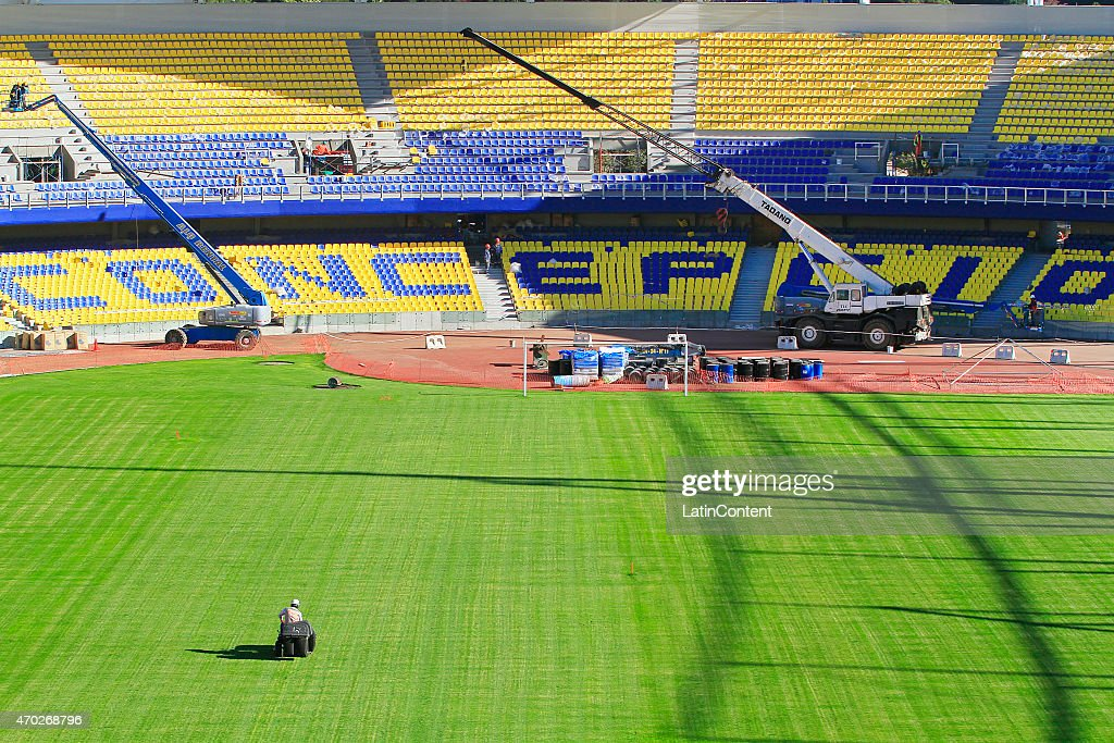 A worker mowes the field of Estadio Municipal de Concepción Alcaldesa Ester Roa Rebolledo prior to Copa America Chile 2015 at Concepcion, Chile on April 17, 2015.