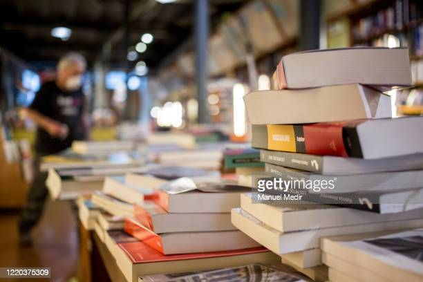 Worker of Altair bookstore prepares the shipments of books for the feast of Sant Jordi on April 22, 2020 in Barcelona, Spain. San Jordi is one of the...