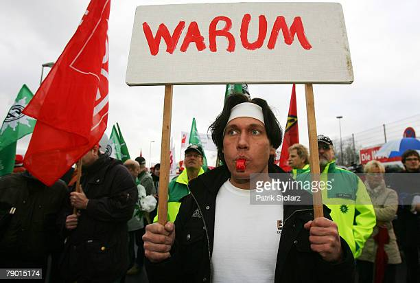 A worker of Finland's mobile phone manufacturer Nokia demonstrate with a display on January 16 2008 in Bochum Germany A confederation of German...