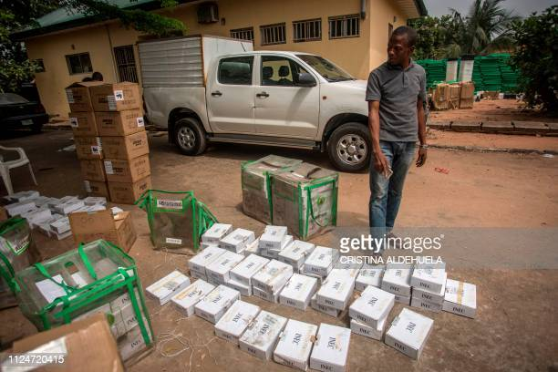 A worker of Independent Nigerian Electoral Commission looks at identity card readers ahead of the country's elections at an INEC office in Umuahia...