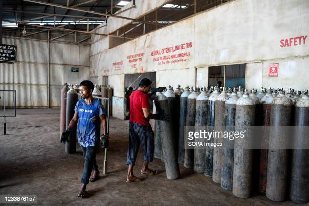 Worker of Islam Oxygen Pvt Ltd, processing Oxygen cylinders before they are filled in the plant. Demand for oxygen is increasing day by day during...