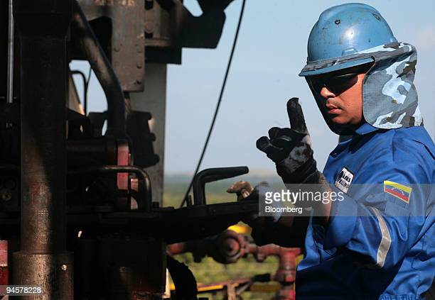 A worker of Nabors Industries Ltd operates a machine on a drilling rig in the Orinoco Belt near San Diego de Cabrutitas 300 miles from Caracas...