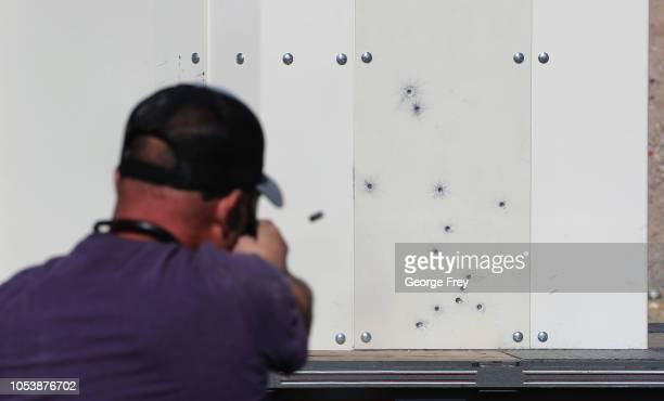 A worker of 'Shelter in Place' fires a 9mm handgun at one of their bullet resistant shelters on October 25 2018 in Cedar City Utah Shelter in Place...