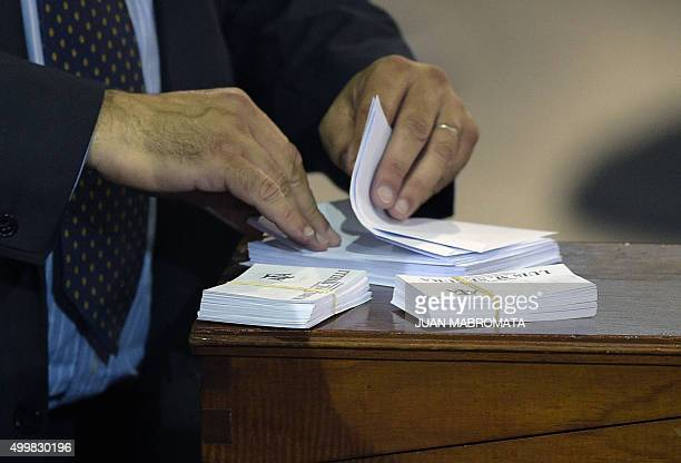A worker of the Argentine Football Association worker prepares ballot papers before the election of a new president in Ezeiza Buenos Aires on...