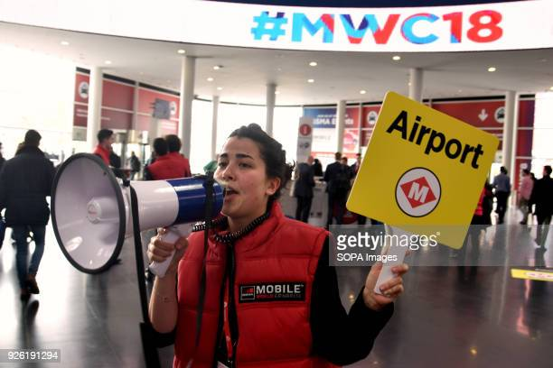 A worker of the GSMA guide visitors to the airport exit at the Mobile World Congress in Barcelona The Mobile World Congress 2018 is being hosted in...