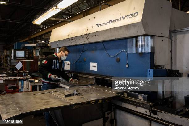 Worker of the Italian company Desmon assembling a part of a refrigerator inside the company's industrial shed in Nusco in Avellino, southern Italy,...