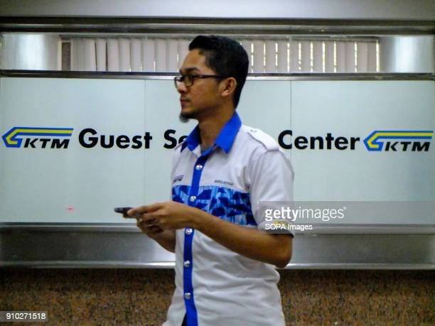 A worker of the Kereta api Tanah Melayu is seen leaving his workplace Kuala Lumpur or commonly known as KL is the national capital for Malaysia and...