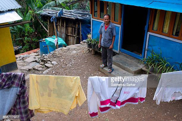 A worker of the Makaibari tea estate poses outside his house Set up in 1859 off Kurseong in the Darjeeling hills the Makaibari estate is the worlds...