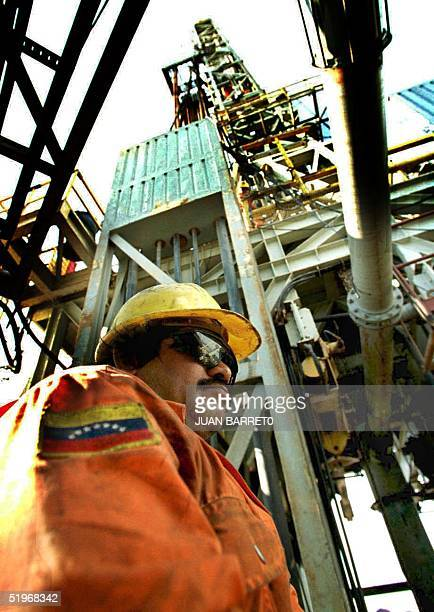 A worker of the Venezuelan Petroleum Company inspects a sound of perforation to search petroleum in Maracaibo 500km West of Caracas Venezuela 22...