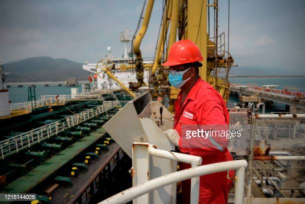 A worker of the Venezuelan state oil company PDVSA looks at the Iranianflagged oil tanker Fortune as it docks at the El Palito refinery in Puerto...