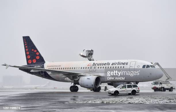 Worker of the Zaventem airport spread deicing on a plane of the Belgian national airplane company Brussels Airlines due to snow falls and the low...
