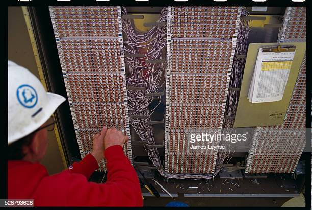 A worker on a Bell Atlantic project to provide video dial tone installs fiber optic cables | Location Dover New Jersey USA