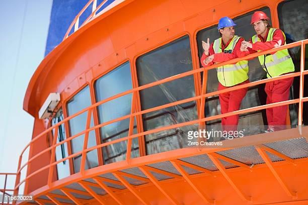 Worker on a floating bridge