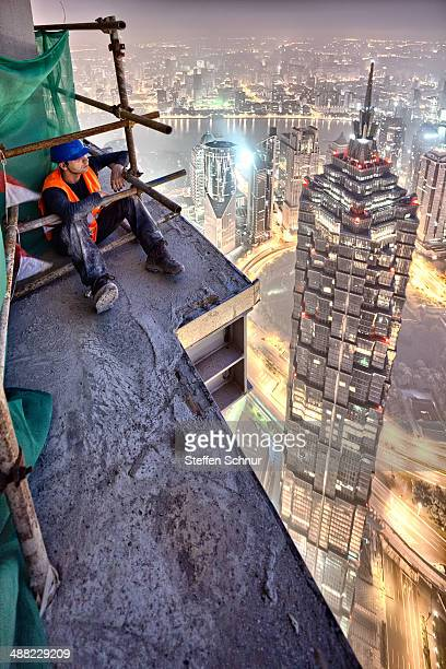 worker on a skyscraper in China
