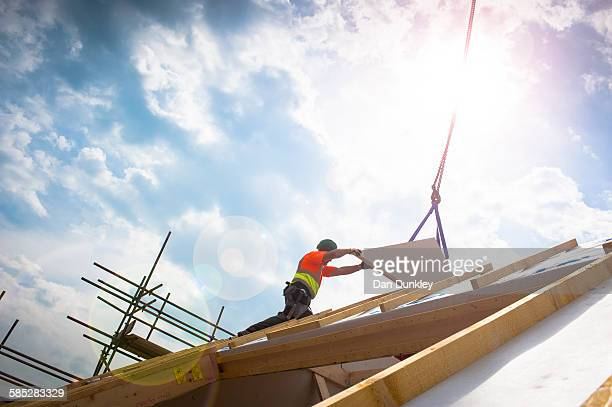worker on construction site - housing development stock pictures, royalty-free photos & images