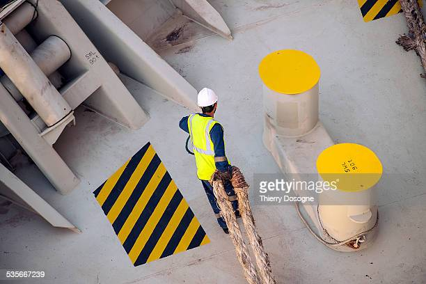 worker on container ship