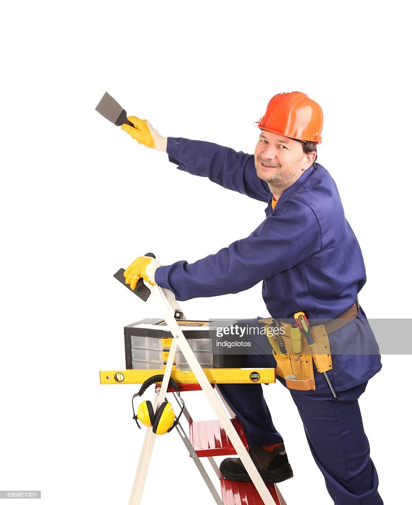 Worker on ladder with spatula. : Stock Photo