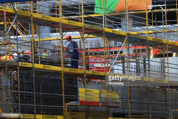Worker on the Quartier Heidestrasse residential building project in Berlin, Germany, on Thursday, July 29, 2021. Germany reports gross domestic...