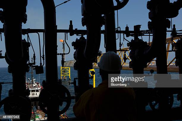 A worker opens a valve on the Petroleos Mexicanos PolA Platform complex above the continental shelf in the Gulf of Mexico 70 kilometers offshore from...