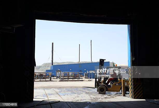 A worker operates a Caterpillar Inc forklift outside the No 1 shaft building at the Oyu Tolgoi coppergold mine jointly owned by Rio Tinto Group's...