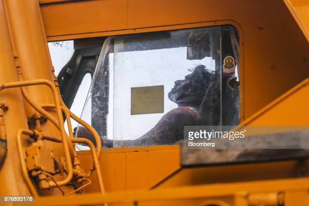 A worker operates a crane at Krishnapatnam Port in Krishnapatnam Andhra Pradesh India on Friday Aug 11 2017 Growth in gross domestic product slipped...