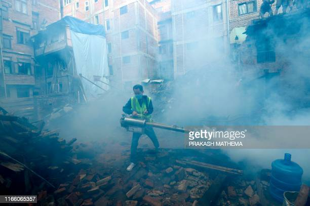 TOPSHOT A worker operates a fogging machine to kill mosquito larvae to fight the spread of dengue fever and other mosquitoborne diseases in a...