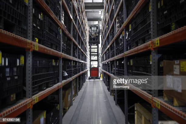 A worker operates a forklift to retrieve parts used in the assembly of combine harvesters at the CLAAS of America Inc production facility in Omaha...