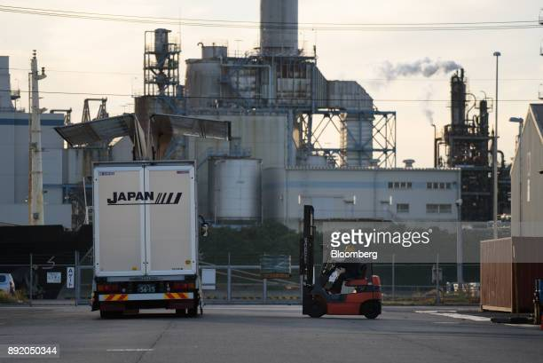 A worker operates a forklift truck in the Keihin industrial area of Kawasaki Kanagawa Prefecture Japan on Tuesday Dec 12 2017 The Bank of Japan will...
