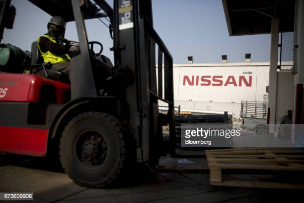 A worker operates a forklift truck outside the Nissan Motor Co plant in Samut Prakan Thailand on Tuesday April 25 2017 Nissan andMitsubishi Motors...