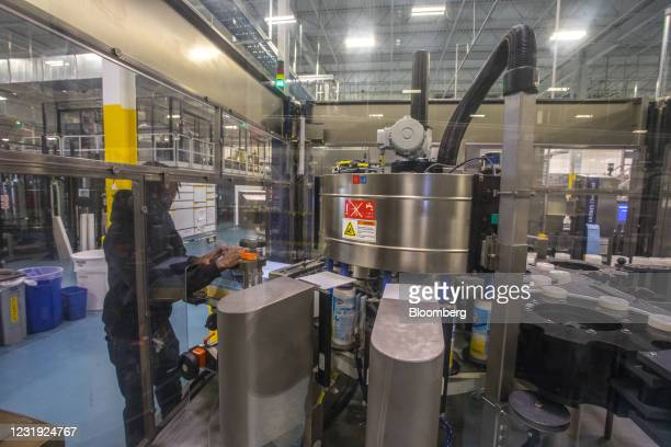 Worker operates a machine labeling canisters of Clorox Disinfecting Wipes at the company's manufacturing facility in Forest Park, Georgia, U.S., on...