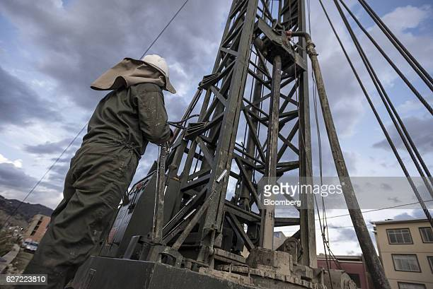 A worker operates a machine to drill wells in the Irpavi zone of La Paz Bolivia on Monday Nov 28 2016 Bolivia has declared a state of emergency as a...