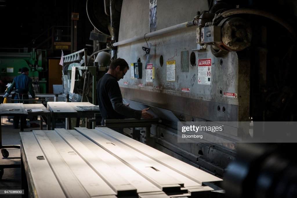A worker operates a press brake to bend metal at the Metal Manufacturing Co. facility in Sacramento, California, U.S., on Thursday, April 12, 2018. The Federal Reserve is scheduled to release industrial production figures on April 17. Photographer: David Paul Morris/Bloomberg via Getty Images