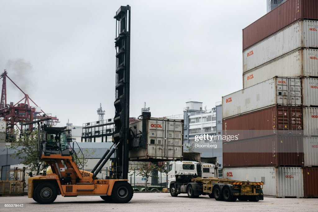 A worker operates a straddle carrier at the Kwai Tsing Container Terminals in Hong Kong, China, on Friday, March 17, 2017. Hong Kong is scheduled to release trade figures on March 27. Photographer: Anthony Kwan/Bloomberg via Getty Images