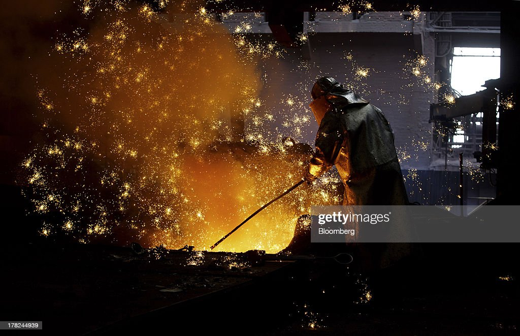 A worker operates in the blast furnace at ArcelorMittal's steel plant in Ostrava, Czech Republic, on Monday, Aug. 26, 2013. ArcelorMittal, the world's biggest steelmaker, said steel shipments will rise 1 percent to 2 percent this year compared with an earlier forecast of 2 percent in May. Photographer: Martin Divisek/Bloomberg via Getty Images