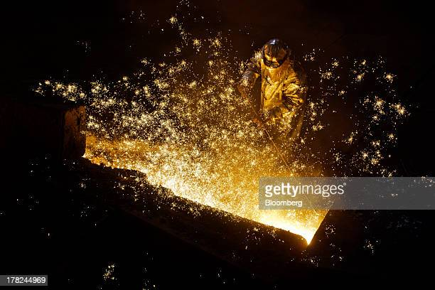 Worker operates in the blast furnace at ArcelorMittal's steel plant in Ostrava, Czech Republic, on Monday, Aug. 26, 2013. ArcelorMittal, the world's...