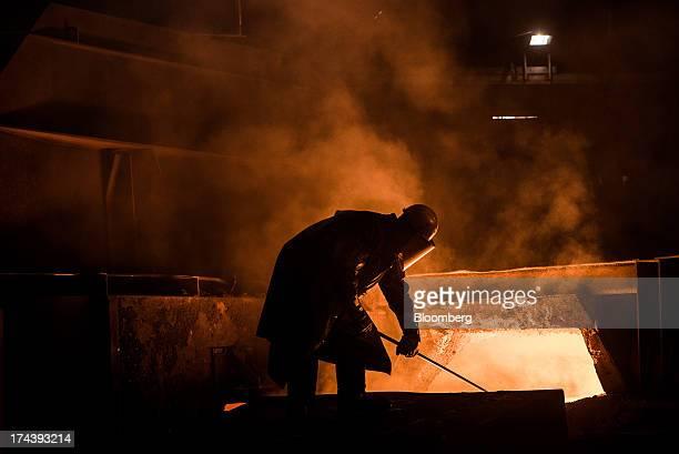A worker operates in the blast furnace in Voestalpine AG's steel plant in Linz Austria on Wednesday July 24 2013 Voestalpine Austria's biggest...