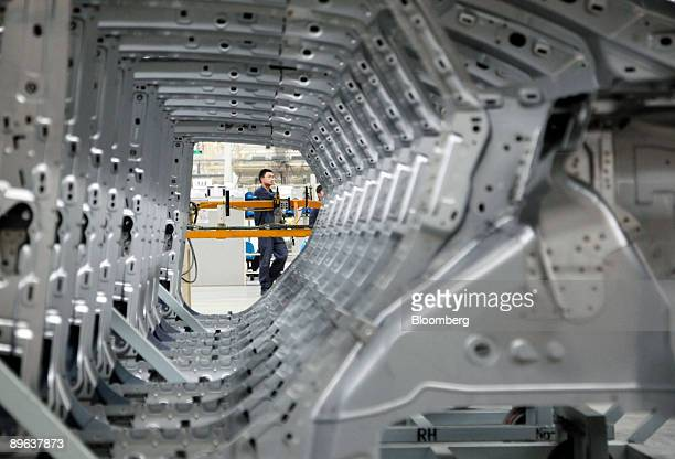 A worker operates the assembly line at the Changan Ford Mazda Plant in Nanjing China on Thursday July 9 2009 Ford Motor Co said it intends to outpace...