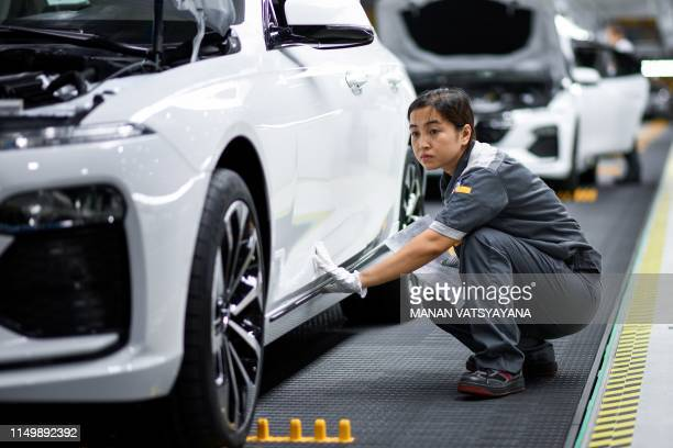 A worker operates the car assembly line at the new automobile plant of VinFast Vietnam's first homegrown car manufacturer in Haiphong on June 14 2019