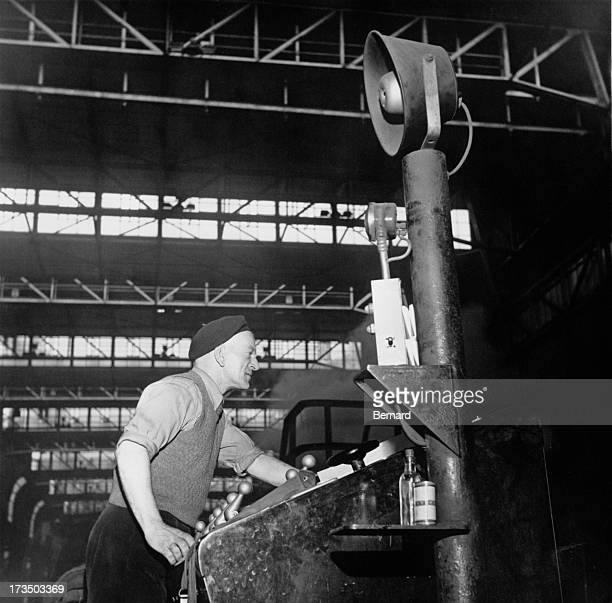 A worker operating equipment at the Abbey Steelworks Margam Port Talbot South Wales October 1961